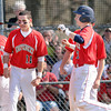 F. BRIAN FERGUSON/THE REGISTER-HERALD=Independence's Wyatt Adkins celebrates hitting a home run with his team as they took on Liberty on Thursday evening in Coal City.