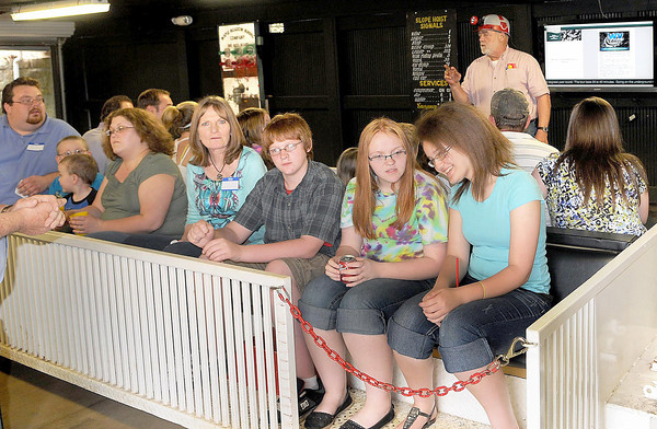F. BRIAN FERGUSON/THE REGISTER-HERALD=Parents and children loaded in to take a tour of the Beckley Exhibition Coal Mine during Thursday evening's Business After Hours event.