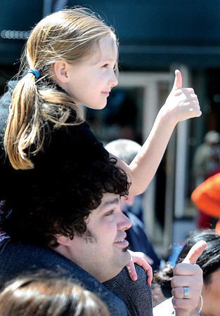 F. BRIAN FERGUSON/THE REGISTER-HERALD=Madison Bender, 6, and her Uncle Seth Young, both of Elkins, give two thumbs up for the 7th Annual Chocolate Festival.