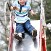 Jay Canterberry, 3, son of Haley and David Edwards, of Beckley, plays on the playground a the Beckley Freedom Park on Eisenhower Drive.<br /> Rick Barbero/The Register-Herald