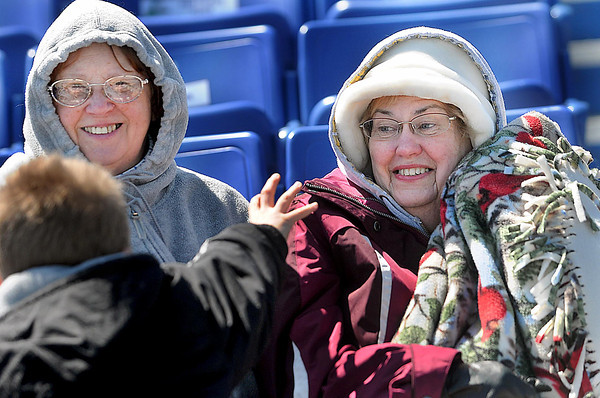F. BRIAN FERGUSON/THE REGISTER-HERALD=THE BOYS of SUMMER?= Payton Fowler,7, left, tries to help Maxine Donell, center and Clera Cox, right, keep their spirits up as they battle Tuesday's chilly conditions while cheering on the Independence baseball team as they took on Greenbrier West at Linda K. Eppling Stadium.
