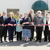 F. BRIAN FERGUSON/THE REGISTER-HERALD=The ribbon was cut to mark the official opening of the Women's Business Center in Harper Park.