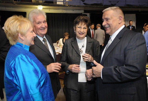 Frank Wood, right, and his wife Jo Ann, left, talk with John and Florence Denny during Beckley-Raleigh County Chamber of Commerce annual dinner held at the Beckley-Raleigh County Convention Center Friday evening.<br /> Rick Barbero/The Register-Herald