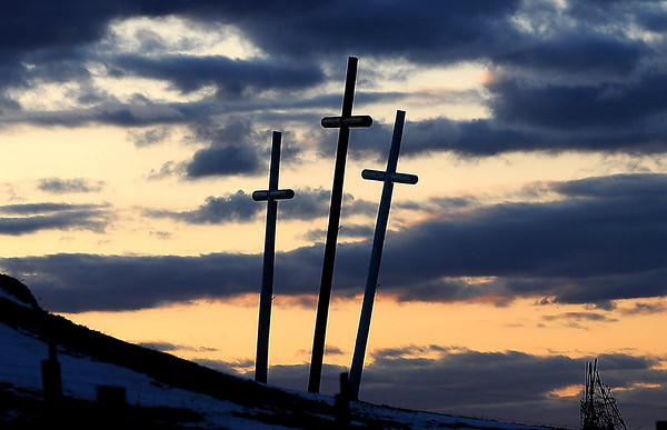 F. BRIAN FERGUSON/THE REGISTER-HERALD=A set of the three blue and gold crosses that were planted by Rev. Bernard Coffindaffer around West Virginia as well as in many eastern states, are brought to life by a colorful sky along Gatewood Road in Fayette County.