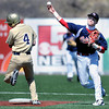 F. BRIAN FERGUSON/THE REGISTER-HERALD=Greenbrier West's Dustin Yoakum, left, breaks up a double play attempt by Independence shortstop Wyatt Adkins during Tuesday afternoon play at Linda K. Epling Stadium.