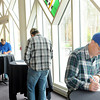 F. BRIAN FERGUSON/THE REGISTER-HERALD=Job Seekers fill out applications during the Register-Herald Spring Job Fair on Wednesday at Tamarack.