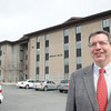 Jerry Forster, University of Charleston Regional President, stands in front of Hogan Hall on South Kanawha Street. Forster announced a special room rate for UC-Beckley residence halls of $1800. for the 2013-14 academic school year.<br /> Rick Barbero/The Register-Herald