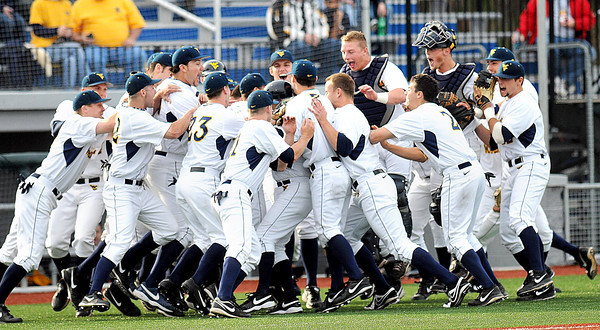 F. BRIAN FERGUSON/THE REGISTER-HERALD=The WVU Mountaineer Baseball team gets fired up as they take the field at Linda K. Epling Stadium to play Kansas on Friday evening.