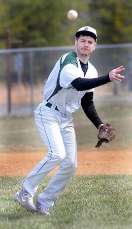 F. BRIAN FERGUSON/THE REGISTER-HERALD= Fayettevile's Trey Phares throws the runner out at first base as the Pirates took on Westside during Thursday action in Fayetteville.