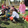 F. BRIAN FERGUSON/THE REGISTER-HERALD=Harmony Preschoolers help plant a Bartlett Pear Tree outside the School of Harmony in Beaver during Monday's Earth Day.