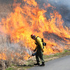 National Park Service conducted a prescribed burn near the Sandstone visitors center Wednesday morning.<br /> Rick Barbero/The Register-Herald