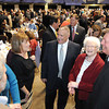 Frank Wood, center, gets greeted by a large crowd during Beckley-Raleigh County Chamber of Commerce annual dinner held at the Beckley-Raleigh County Convention Center Friday evening.<br /> Rick Barbero/The Register-Herald