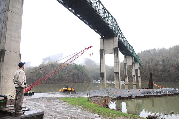 Andy Powell, project engineer Division of Highways, left, looks at the old bridge and the constuction site where the new Lilly bridge will be built in Summers Co.<br /> Rick Barbero/The Register-Herald