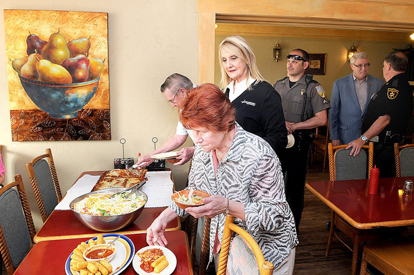 F. BRIAN FERGUSON/THE REGISTER-HERALD=Crime Stoppers had a Thursday lunch with Fayette County officers at Guieseppes on Main Street in Mt. Hope.