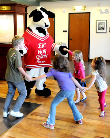 F. BRIAN FERGUSON/THE REGISTER-HERALD=Children enjoyed the Chic-fil-A cow during Family Night at the Beckley Exhibition Coal Mine as part of Thursday evening's Business After Hours event.