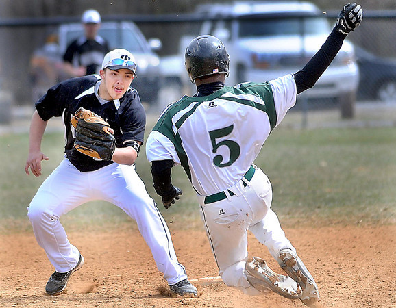 F. BRIAN FERGUSON/THE REGISTER-HERALD=Westside's Dakota Paynter, left, puts the tag on Fayettevile's Brian Gore, right, on an attempted steal of second base during Thursday action in Fayetteville.