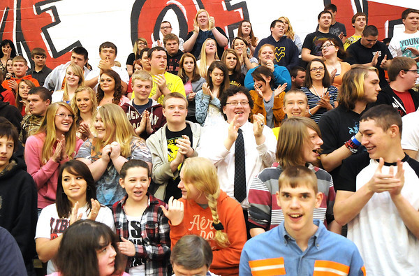 Students at Liberty High School clab after GOOD and University of Phoenix named Liberty High School teacher Everett Jeremy Rodriguez the winner of the 2013 Great American Teach-Off. <br /> Rick Barbero/The Register-Herald