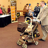 F. BRIAN FERGUSON/THE REGISTER-HERALD=Job Seeker Matt Helton, right, of Shady Spring, brought his young family including wife, Carolyn Helton, and sons Maddox and Benson to the Register-Herald Spring Job Fair on Wednesday at Tamarack.