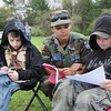 Senior Master Sgt. Lyon Heera, center, helps Gus Hartsock, left, and Nick Young, both in Boy Scout troop 6, fill out incident command system forms, during the Boy Scout Spring Campboree at Little Beaver State Park.<br /> Rick Barbero/The Register-Herald