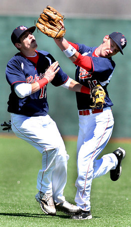 F. BRIAN FERGUSON/THE REGISTER-HERALD=Independence second baseman Drew D'Angelo, left, and right fielder Daniel Kasteoko, right, ? collide as the attempt to catch a fly ball in shallow right field.Kasteoko held onto the ball for the out against Greenbrier West.