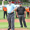 Mark Smith, umpire Beckley Little League, throws out the first pitch to open the season for minor and major leagues Saturday morning.  Smith has been with Beckley Little League for 30 years.<br /> Rick Barbero/The Register-Herald