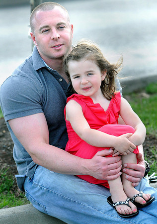 F. BRIAN FERGUSON/THE REGISTER-HERALD=Josh Humphery and his daughter Cailyn, 4, both of Beckley share a moment during Daddy -Daughter night on Thursday evening at Chick-fil-A.