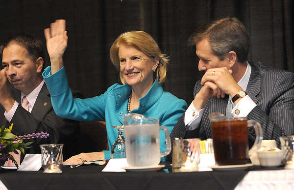 Shelley Moore Capito with her husband Charlie, right, waves to the crowd during Beckley-Raleigh County Chamber of Commerce annual dinner held at the Beckley-Raleigh County Convention Center Friday evening<br /> Rick Barbero/The Register-Herald
