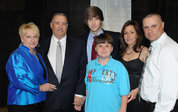 Jo Ann and Frank Wood, left pose with family members, Austin Wood, grandson, Erin Wood, daughter in law, Shaun Wood, son and Hunter Wood, grandson, during Beckley-Raleigh County Chamber of Commerce annual dinner held at the Beckley-Raleigh County Convention Center Friday evening.<br /> Rick Barbero/The Register-Herald