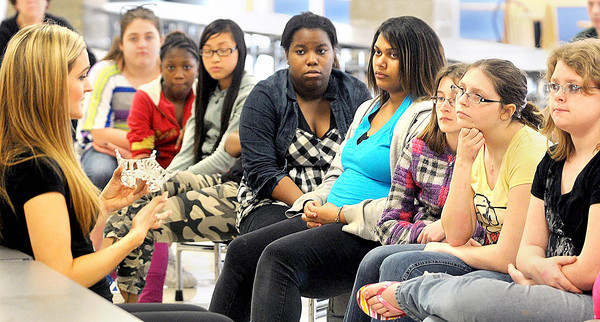 """F. BRIAN FERGUSON/THE REGISTER-HERALD=Miss West Virginia 2012, Kaitlin Gates, left, talks to Beckley-Stratton Middle School students about her """"Healthy Kids, Healthy Futures"""" program, which targets childhood obesity, during a Thursday after school program."""
