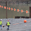 Workers for Broyman Construction Corp., rope off the area where constuction of the new Lilly Bridge is being built near the Bluestone Dam in Summers Co.<br /> Rick Barbero/The Register-Herald