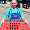 F. BRIAN FERGUSON/THE REGISTER-HERALD=Zoe Hinkey, 10, of Lewisburg hands out chocolate treats during the 7th Annual Chocolate Festival.