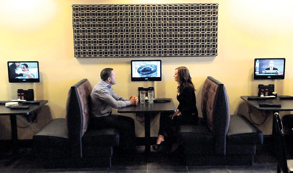 F. BRIAN FERGUSON/THE REGISTER-HERALD=Every booth has its own TV at the Dish Cafe on Ritter Drive in Daniels.
