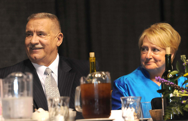 Frank and Jo Ann Wood listens to Victor Flanagan speak during Beckley-Raleigh County Chamber of Commerce annual dinner held at the Beckley-Raleigh County Convention Center. Friday evening.<br /> Rick Barbero/The Register-Herald