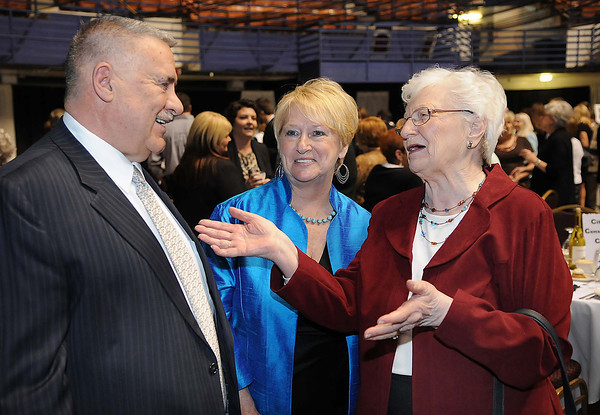 Frank and Jo Ann Wood talk with Elsie Cochran, of Shady Spring, right, during Beckley-Raleigh County Chamber of Commerce annual dinner held at the Beckley-Raleigh County Convention Center. Friday evening.<br /> Rick Barbero/The Register-Herald