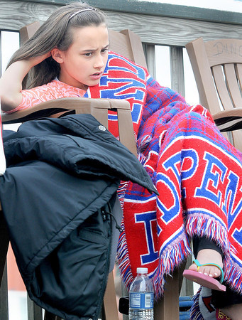 F. BRIAN FERGUSON/THE REGISTER-HERALD=Lillian Perdue, 9, of Beckley tries to keep warm as she checks out the action at the Beckley Motorsports Park on Friday evening.