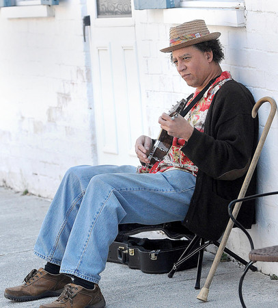 F. BRIAN FERGUSON/THE REGISTER-HERALD=Keith Thomas plays some tunes during the 7th Annual Chocolate Festival.