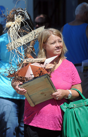 April Lilly of Daniels brings home a prize craft from Saturday's Appalachian Festival at the Raleigh County Convention Center. F. Brian Ferguson/The Register-Herald