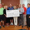 The Third Annual Elsie Pruett Endowment Fundraiser was held on June 7, 2013 at White Oak Country Club. This year's event has generated over $25,000 for the endowment, Pictured with check from left, Mike McCauley, Linda Dubba, Bob Pruett, Elsie Pruett, Woody Duba, Brad Compton and Tim Oliver.<br /> Rick Barbero/The Register-Herald