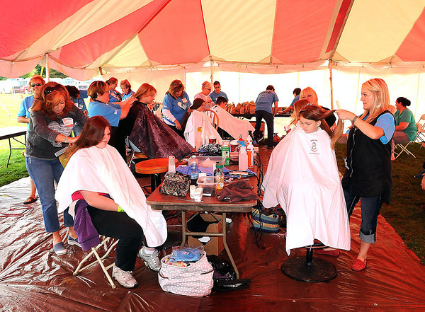 Free Haircuts were provided during Saturday's Day of Hope event at the YMCA Soccer Complex. F. Brian Ferguson/The Register-Herald