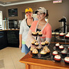 Katie Hendrix, manager, left, and Elise Dixon, owner of Instant Karma Cupcakes on 507 Second Street in Beckley.<br /> Rick Barbero/The Register-Herald