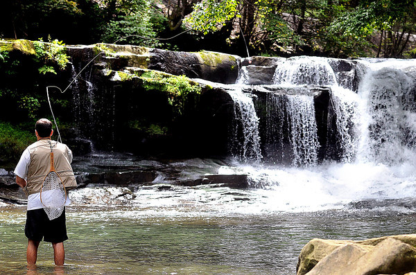 Rusty Gust casts his line into Dunloup Creek Falls, near Thurmond, during a great day of Fly Fishing on Wednesday. F. Brian Ferguson/The Register-Herald