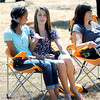 Mariel Macias, left, Jennia Arthur, center, and Sherry Arthur, right, take in the music during Saturday's Simple Jazz and Blues Festival at Sandstone. F. Brian Ferguson/The Register-Herald