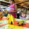 Appalachian Angel Jovie Mains, left, Hallyna Fluker, center, and Lexie Oiler, right, learn all they can about honey bees during the Raleigh County Library's Bee a Reader event on Saturday morning. F. Brian Ferguson/The Register-Herald