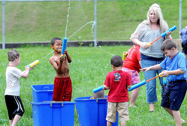 Children enjoy one last summer event on Saturday as Mt. Hope Municipal Stadium played host to a Back to School Community Water Party. F. Brian Ferguson/The Register-Herald