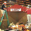 Tony Mullins, left and Johnnie Linville, help setup the Carpenters Loft booth for the Appalachian Arts & Crafts Festival at the Beckley-Raleigh County Convention Center.<br /> Rick Barbero/The Register-Herald