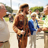 Governor Earl Ray Tomblin, right, speaks with, John Manchester, Mayor of Lewisburg, Jonathan Kimble, mountaineer for WVU and Andrea Pendleton, Mayor of Rainelle, at the West Virginia State Fair in Fairlea.<br /> Rick Barbero/The Register-Herald
