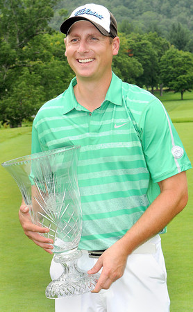 Sam O'Dell gives a big smile after winning the 2013 WV Amateur at the Greenbrier on Thursday afternoon. F. Brian Ferguson/The Register-Herald