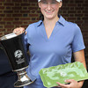 The winner of Thursday's final round of the WV Woman's Amateur at the Resort At Glade, Sydney Snodgrass of Harisville holds her trophy. F. Brian Ferguson/The Register-Herald