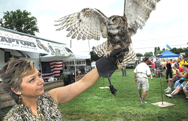 Susan Wood, owner of Extreme Raptors, holds up a owl during the show at the West Virginia State in Fairlea.<br /> Rick Barbero/The Register-herald