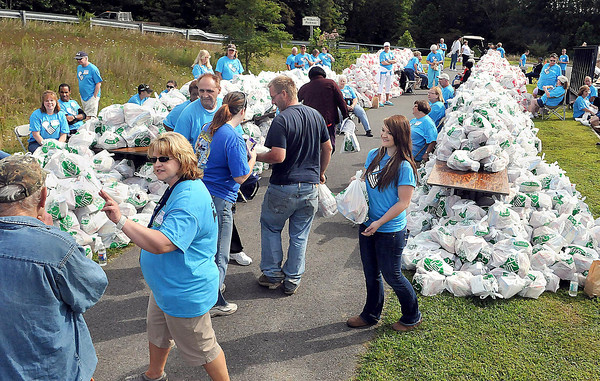 Convoy of Hope Volunteers handed out free groceries during Saturday's Day of Hope event at the YMCA Soccer Complex. F. Brian Ferguson/The Register-Herald